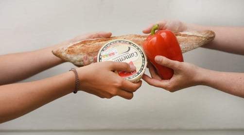 Photo of people sharing food