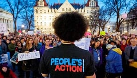 Photo of People's Action representative speaking to a group