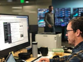 Doxo Employee at Computer