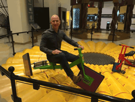 Jeff Bezos Riding The Square-Wheeled Tricycle