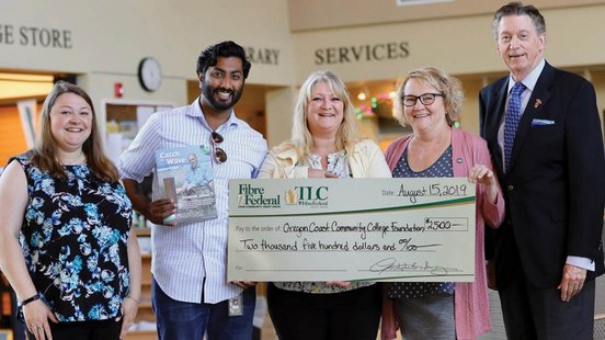 Photo of TLC donating money to community college
