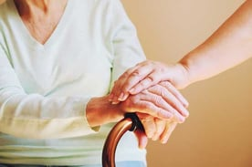 Elderly Woman and Caregiver Hands