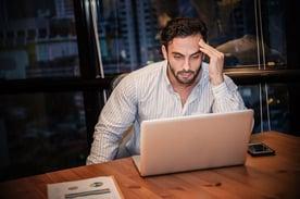 Stressed Man Looking at Laptop