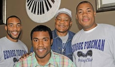 Boxing and grilling George Foreman (second from right) poses with three of his five sons, all of whom are also named George Foreman.