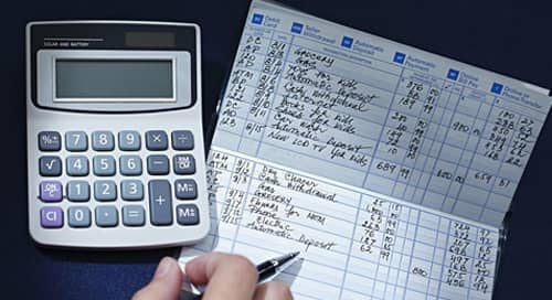 Image of a checkbook and calculator.