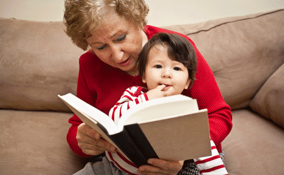 Photo of a Caregiver Reading to a Child