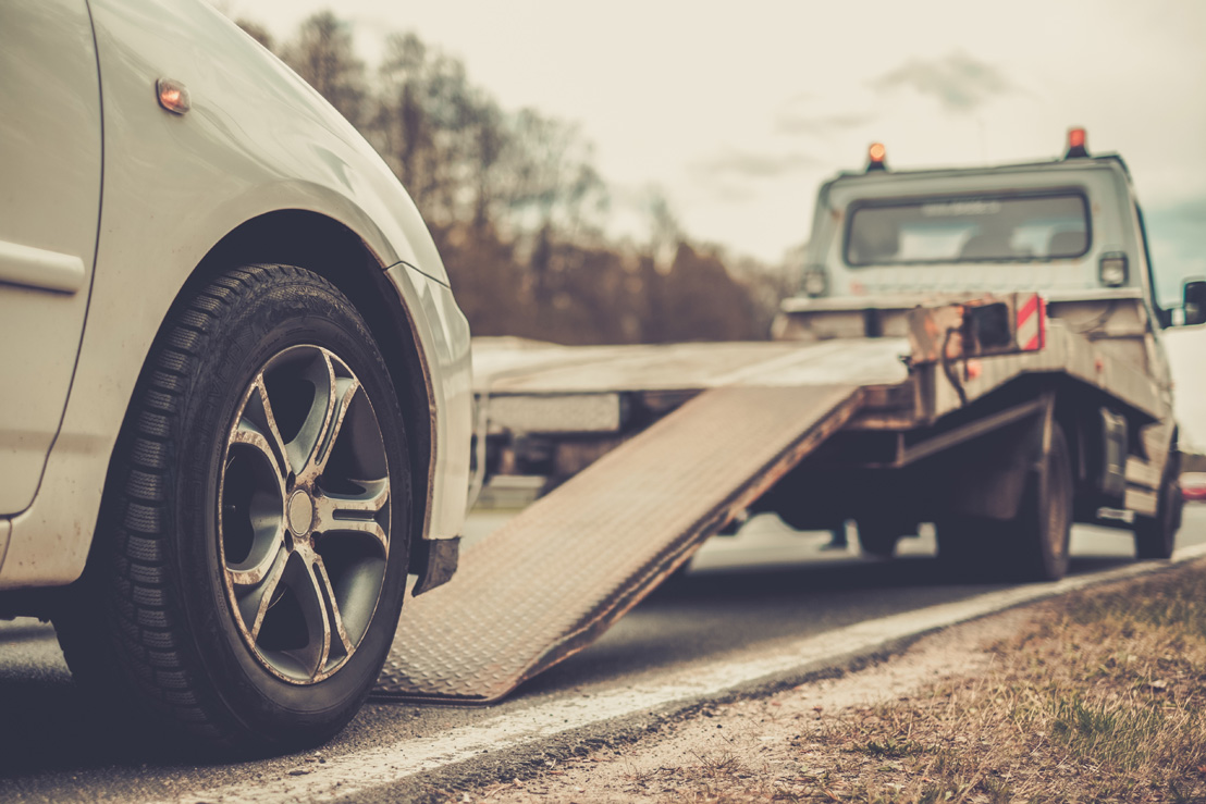 Image of a car being towed