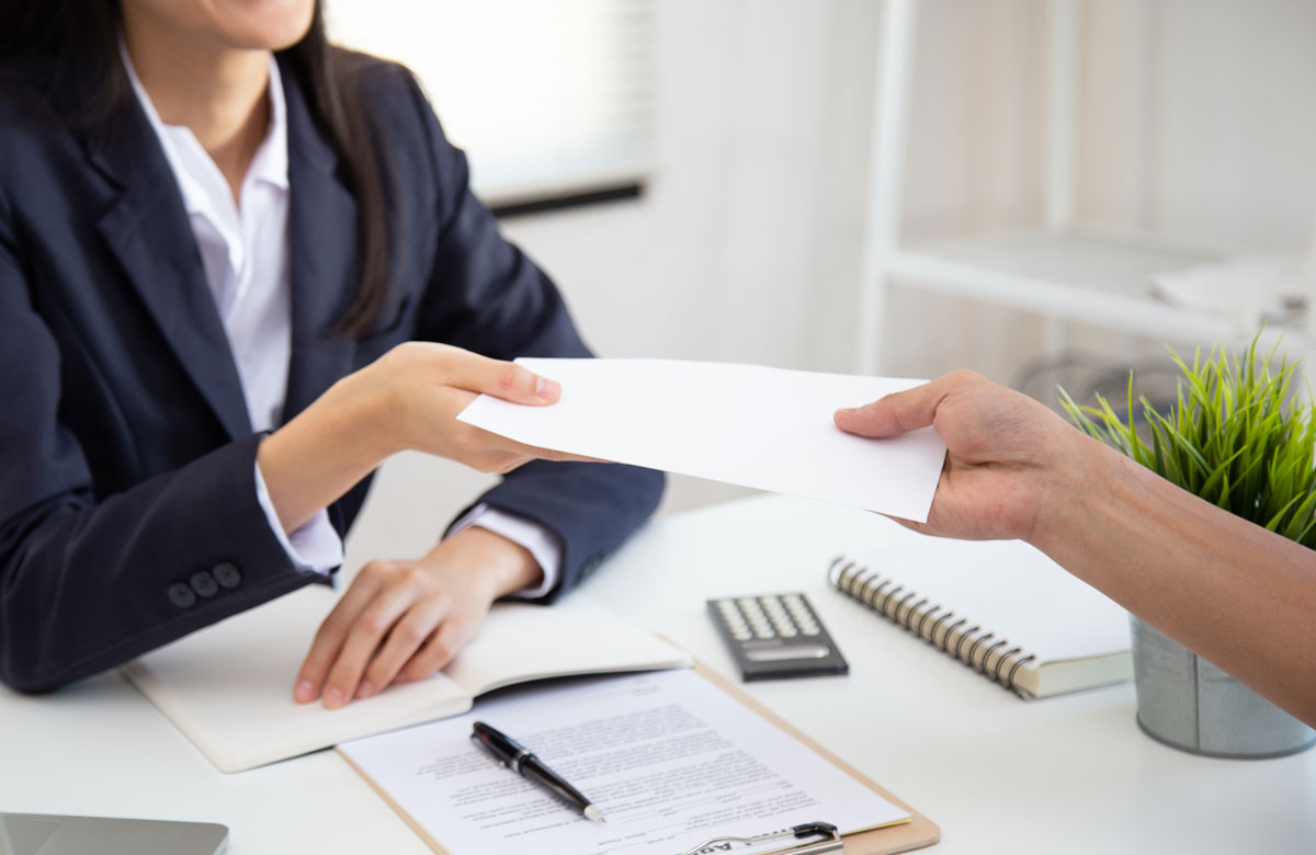 Photo of an Employer Handing Over a Check