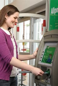 Photo of a Woman Using an Allpoint ATM