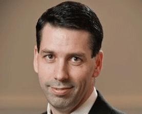 Portrait of Troy Tisserand, Managing Partner for 4 Pillars Consulting